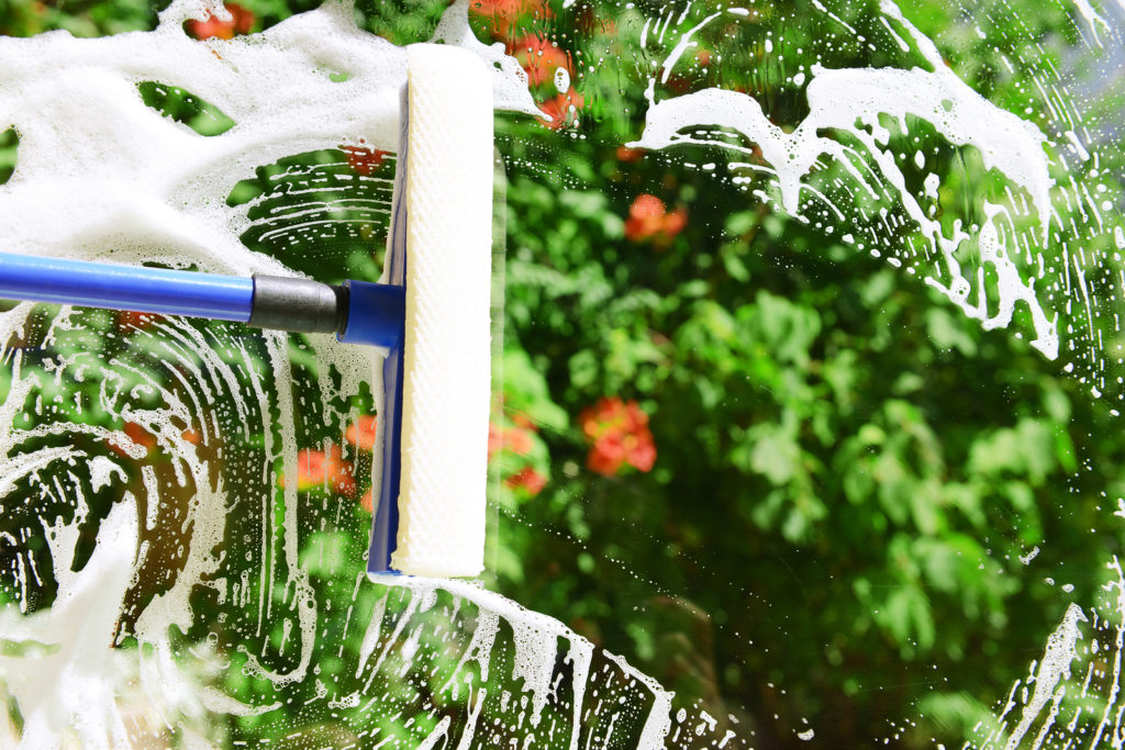 bigstock-Cleaning-windows-with-special-71547079-1024x683