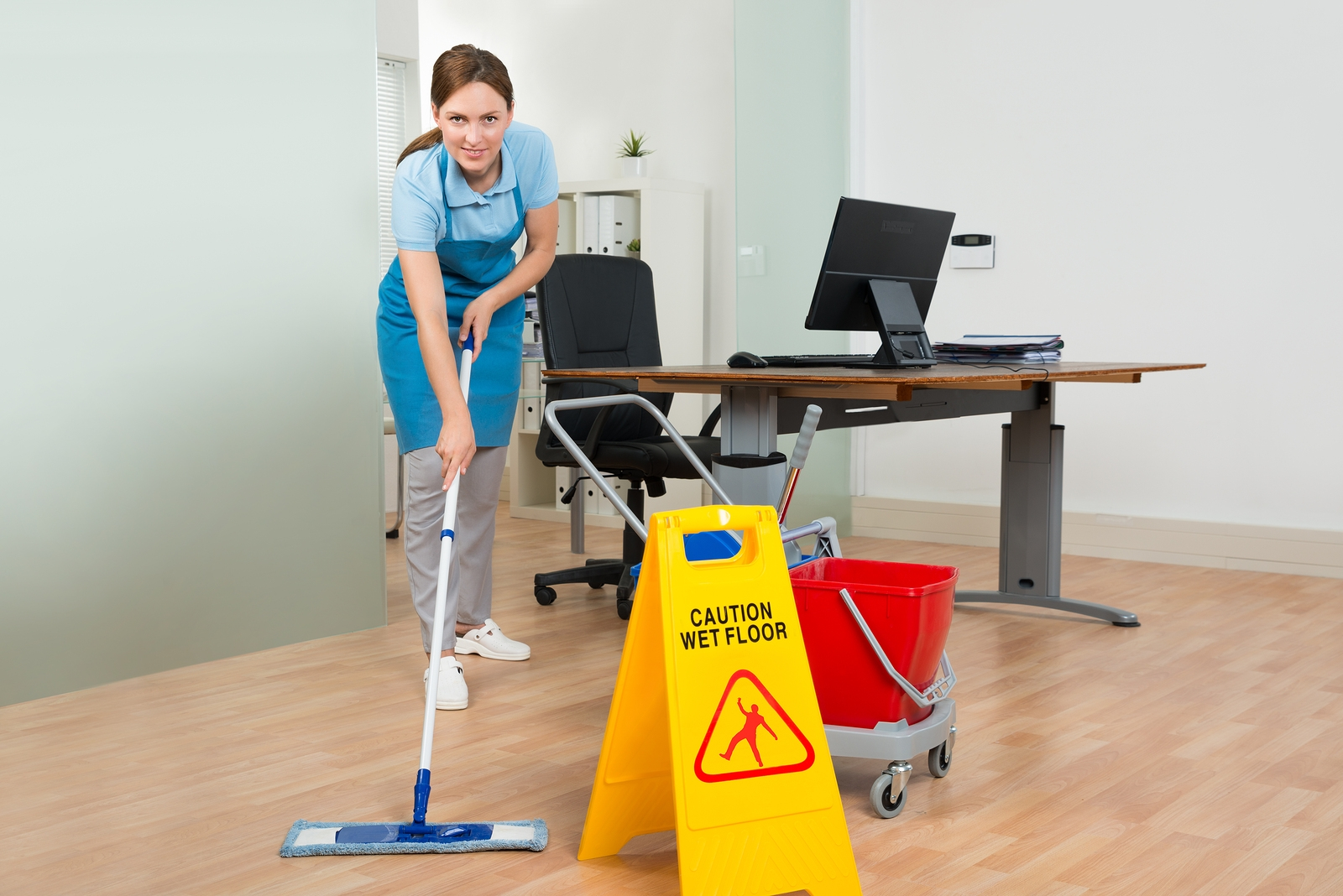bigstock-Female-Janitor-Cleaning-Hardwo-98662658