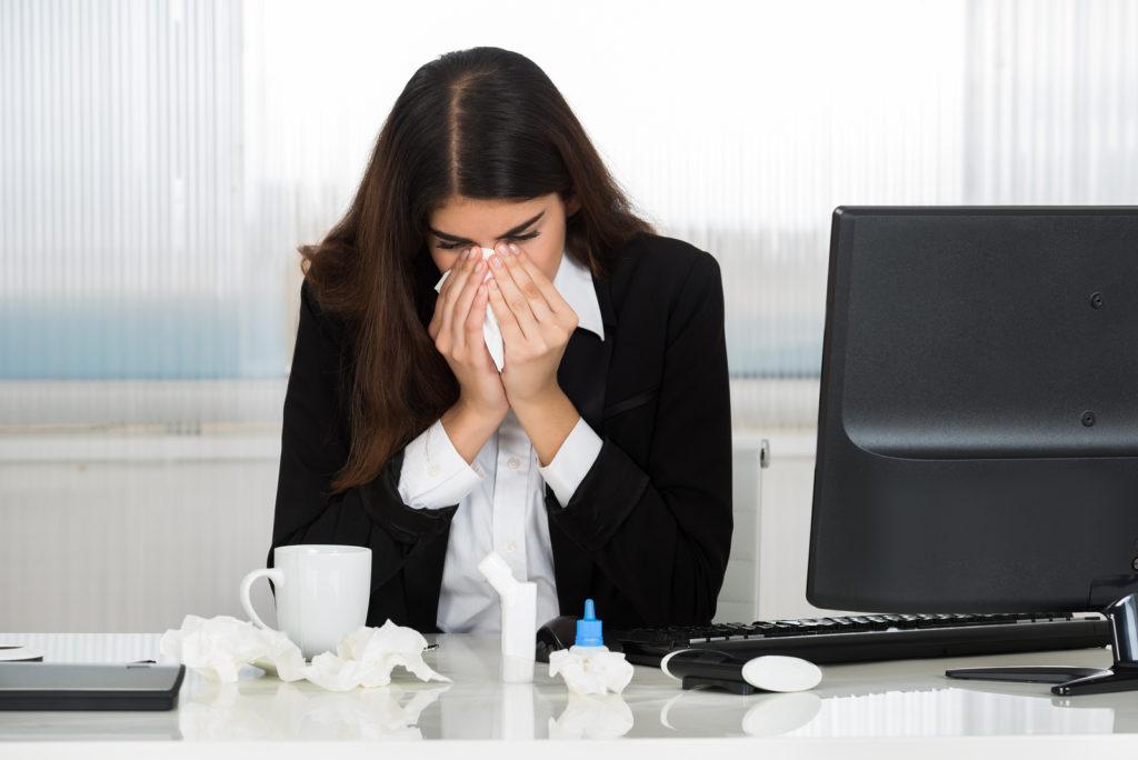 bigstock-Sick-Businesswoman-Blowing-Her-116077778-1024x684
