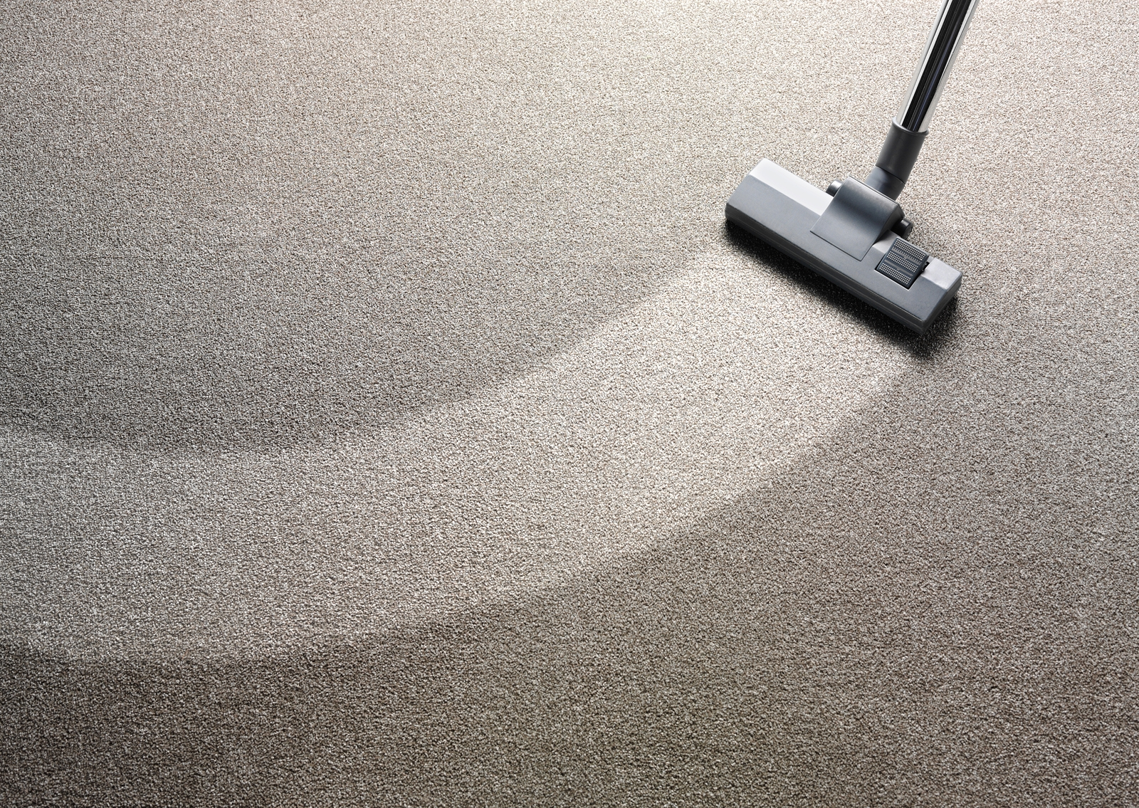 bigstock-Vacuum-Cleaner-on-a-Carpet-76438247